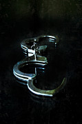 Glass Table Reflection Art - Handcuffs on Black by Jill Battaglia