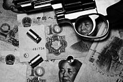 Cash Money Framed Prints - Handgun On Chinese Yuan Cash With Used 9mm Shells Framed Print by Joe Fox