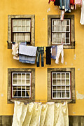 Yellow Line Framed Prints - Hanging Clothes of Old World Europe Framed Print by David Letts