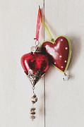 Sandra Cunningham - Hanging ornaments on white background