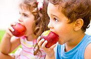 Kid Eating Snack Prints - Happy children eating apple Print by Anna Omelchenko