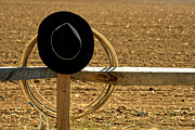 Stetson Framed Prints - Hat and Lasso on Fence Framed Print by Olivier Le Queinec