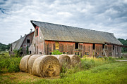 Farm Scenes Photos - Hay bales and old barns by Gary Heller