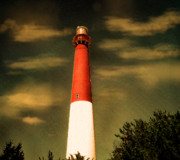 Barnegat Lighthouse Framed Prints - Head in the clouds Framed Print by Colleen Kammerer