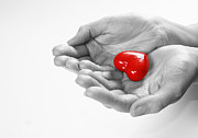 Giving Photos - Heart in hands by Michal Bednarek