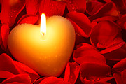 Candle Lit Prints - Heart shape candle and rose petals Print by Richard Thomas