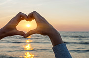 Making Photos - Heart shaped hands framing ocean sunset by Elena Elisseeva