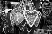 German Candy Posters - heart shaped Lebkuchen hanging on a christmas market stall in Berlin Germany Poster by Joe Fox