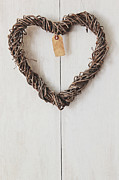 Sandra Cunningham - Heart wreath hanging on wood background