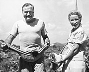 Man And Woman Prints - Hemingway, Wife And Pets Print by Underwood Archives