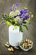 Tablets Photo Prints - Herbal medicine and plants Print by Elena Elisseeva