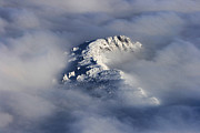 Divide Prints - High Mountain Snow Caps Peaking Through the Clouds Print by James Bo Insogna