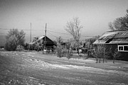 hoar frost covered street in small rural village of Forget Saskatchewan Canada Print by Joe Fox
