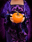 Black Dress Metal Prints - Holding Pumpkin Metal Print by Christopher and Amanda Elwell