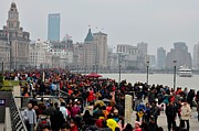 Throng Posters - Holiday crowds throng the Bund in Shanghai China Poster by Imran Ahmed