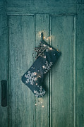 Sandra Cunningham - Holiday stocking with lights hanging on old door