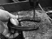 Smithy Photos - Horseshoe and hand of a blacksmith by Matthias Hauser