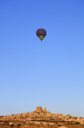 Hot Air Balloon Photos - Hot air balloon and Uchisar castle rock formation Cappadocia by Robert Preston