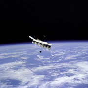 Space Art - Hubble Telescope and Earth by The  Vault