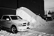 Huge Photo Prints - huge pile of snow cleared from parking lot in Saskatoon Saskatchewan Canada Print by Joe Fox