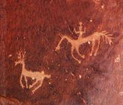 Petroglyph Prints - Hunter and the Hunted Print by Joe Kozlowski