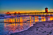 Water Reflections Framed Prints - Huntington Beach Pier Sundown Framed Print by Jim Carrell