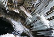 Icicles Photos - Icicles hanging in rocky gorge in cold winter by Matthias Hauser