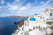 Greek Icon Framed Prints - Iconic blue domed churches in Oia Santorini Greece Framed Print by Matteo Colombo