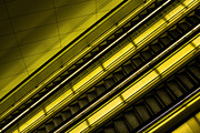Escalator Prints - Illuminated Escalator  Print by Jimmy Callian