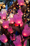Colored Paper Prints - Illuminated Silk flowers in Bangkok Thailand Print by Fototrav Print