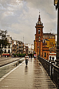 In-city Digital Art Framed Prints - In the Rain - Puente de Triana Framed Print by Mary Machare