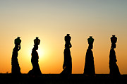 Figures Photo Metal Prints - Indian Women Carrying Water Pots At Sunset Metal Print by Tim Gainey
