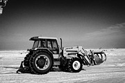 Harsh Conditions Framed Prints - international 5140 tractor with front end loader on frozen field Forget Saskatchewan Canada Framed Print by Joe Fox
