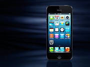 Phones Photos - iPhone 5 on dynamic blue background by Oleksiy Maksymenko