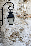 Lamp Worked Posters - Iron lantern on a old brick wall Poster by Kamen Zagorov