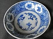 Japanese Ceramics - Japanese Aritaware bowl with intricate floral design by Anonymous artist