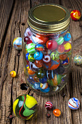 Plaything Photo Framed Prints - Jar of marbles with shooter Framed Print by Garry Gay