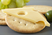 Cheese Framed Prints - Jarlsberg Cheese and Crackers Framed Print by Colin and Linda McKie