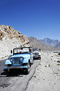 Jeeps Photos - Jeeps on the Karakorum Highway in Pakistan by Robert Preston