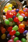 Unhealthy Eating Posters - Jelly Beans Spilling Out Of Glass Jar Poster by Anonymous