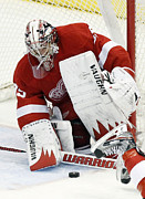 Ice Metal Prints - Jimmy Howard making a save Metal Print by Sanely Great