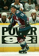 Puck Framed Prints - Joe Sakic in action Framed Print by Sanely Great