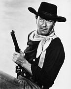 John Photo Framed Prints - John Wayne Framed Print by Silver Screen