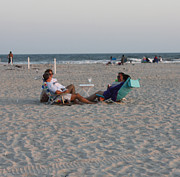 Enjoying Prints - Jones Beach Couples Print by John Telfer