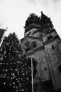 Kudamm Photo Posters - Kaiser Wilhelm Gedachtniskirche memorial church and christmas tree Berlin Germany Poster by Joe Fox