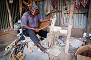 Kenya Photos - Kenya. December 10th. A man carving figures in wood. by Michal Bednarek