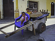 Young Colonial Boy Photos - Kids in Wooden Wheel Barrel by Camilla Fuchs