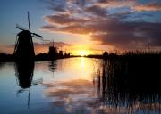 Windmills Framed Prints - Kinderdijk Sunrise Framed Print by David Bowman