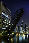 Draw Bridge Prints - Kinzie Street railroad bridge at night Print by Sebastian Musial