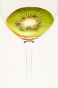 Kiwi Posters - Kiwi fruit cut in half Poster by Alexander Voss